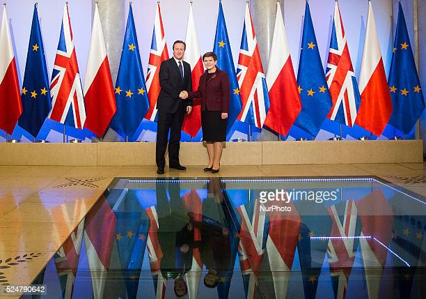 Polish Prime Minister Beata Szydlo welcomes British Prime Minister David Cameron at the Cabinet Office on 10 December in Warsaw, Poland.