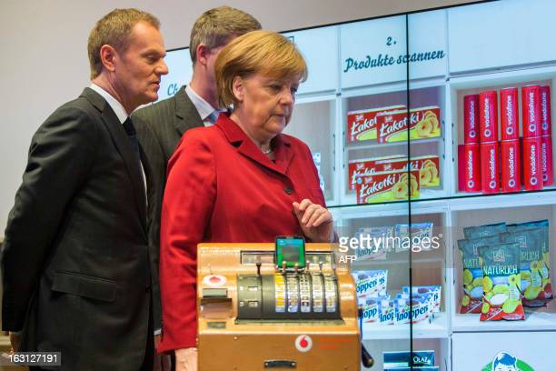Polish Prime Minister Donald Tusk ,Stephan Weil, Prime Minister of Lower Saxony and German Chancellor Angela Merkel arrive at the booth of German...