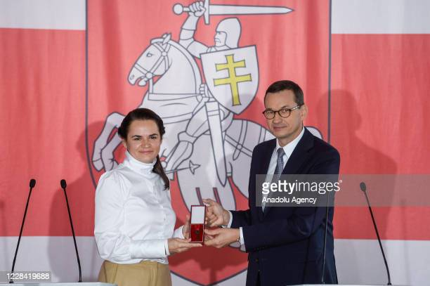 Polish Prime Minister, Mateusz Morawiecki and the Belarus opposition leader Sviatlana Tsikhanouskaya pose for a photo during a meeting in Warsaw,...