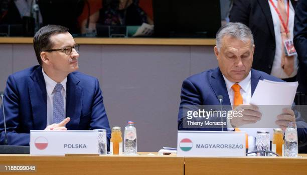 Polish Prime Minister Mateusz Morawiecki and the Hungarian Prime Minister Viktor Mihaly Orban attend the first of a two-day summit of European Union...