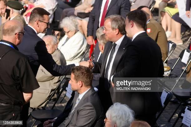 Polish Prime Minister Mateusz Morawiecki shakes hands with North Rhine-Westphalia's State Premier, Christian Democratic Union leader and CDU's...