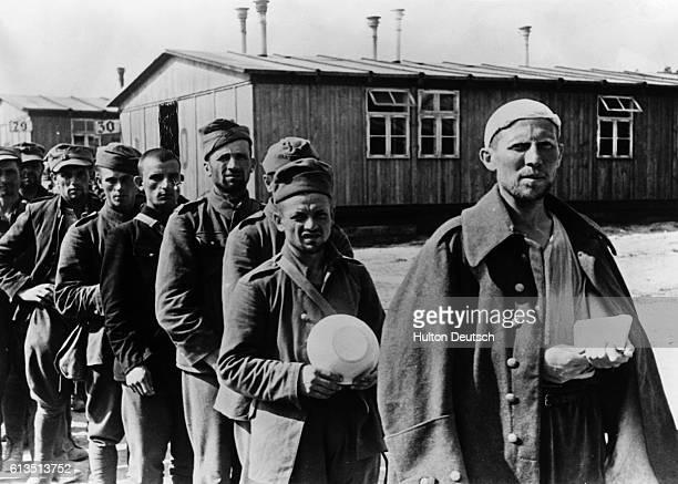 Polish prisoners of war queue for food at a prison camp, September 9, 1939.