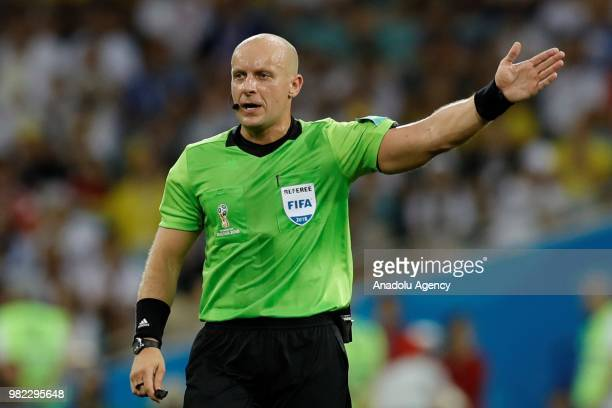 Polish referee of the match Szymon Marciniak gestures during the 2018 FIFA World Cup Russia Group F match between Germany and Sweden at the Fisht...