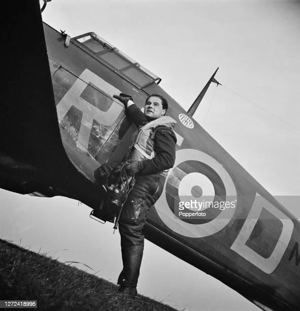 Polish Royal Air Force pilot Jan Zumbach from No 303 Squadron RAF prepares to climb in to the cockpit of his Hawker Hurricane Mk1 RFD fighter...