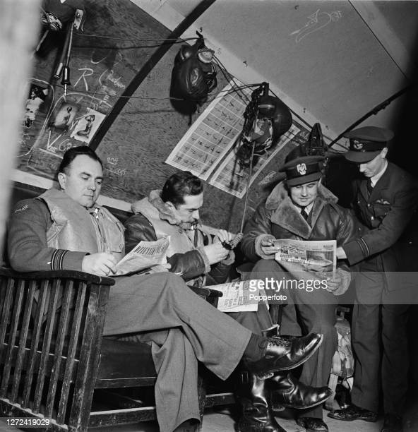 Polish Royal Air Force pilots of No 303 Squadron RAF wait in a Nissan Hut mess room for their next call to scramble and fly from their base in...