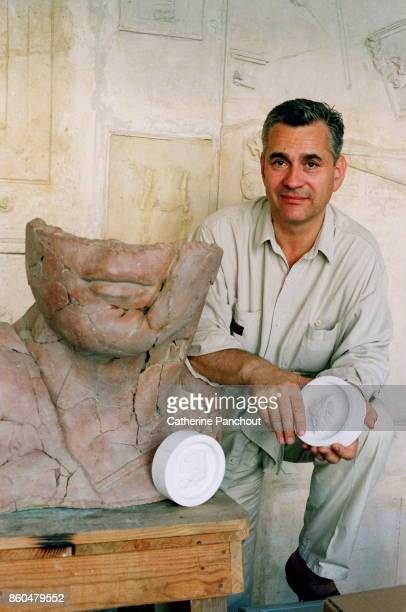 Polish sculptor Igor Mitoraj poses in his workshop on July 26 2017 in Pietrasanta Italy