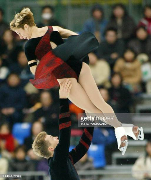 Polish skater Mariusz Siudek throws his partner Dorota Zagorska into the air during pairs press program in the NHK Trophy figure skating competition...