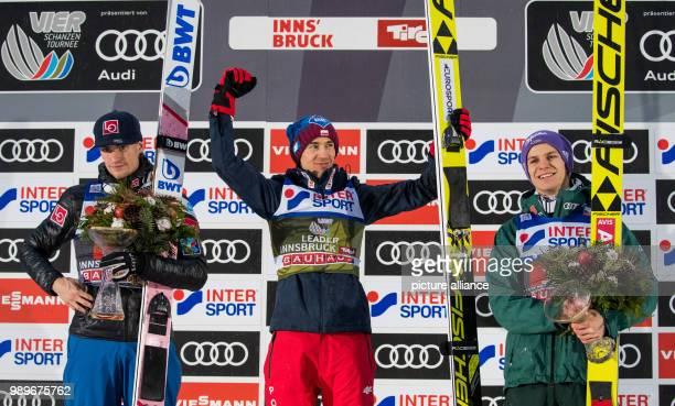 Polish ski jumperKamil Stoch Norwegian ski jumper DanielAndre Tande and German ski jumper Andreas Wellinger stand on the podium after the second...