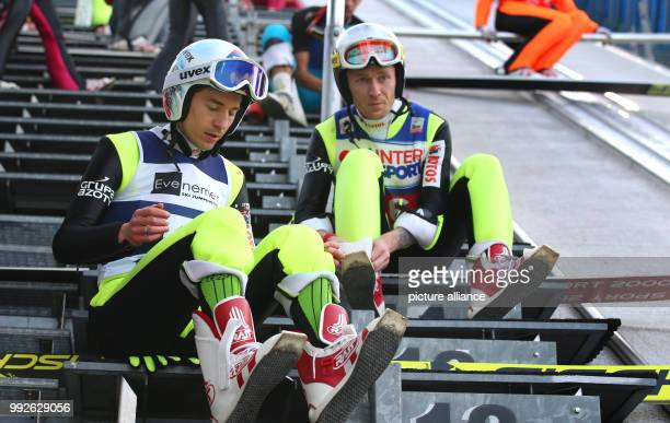 Polish ski jumpers Kamil Stoch and Stefan Hula prepare for a jump in the Erdinger Arena in Oberstdorf Germany 26 October 2017 Photo KarlJosef...