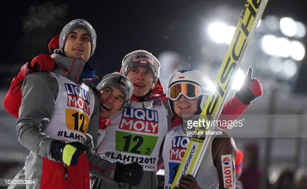 Polish team Maciej Kot Piotr Zyla Dawid Kubacki and Kamil Stoch celebrate their gold in the men's ski jumping team event at the Nordic Ski World...