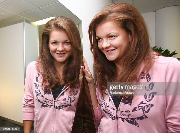 Polish tennis player Agnieszka Radwanska takes a turn in the player Beauty Bar getting her hair done during day eight of the 2013 Australian Open at...