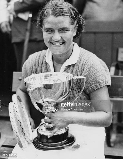 Polish tennis player Jadwiga Jedrzejowska smiling and holding her cup after winning the Beckenham Tennis Final against Alice Marble England June 12th...