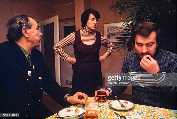 Polish tradeunionist Lech Walesa and his bodyguard Henryk Mazul eat breakfast as Welesa's wife Danuta stands between them in the couple's home Gdansk...