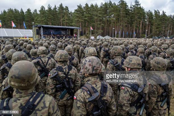 Polish troops attend the official welcoming ceremony for NATO troops part of The Enhanced Forward Presence in Orzysz Poland April 13 2017 The...