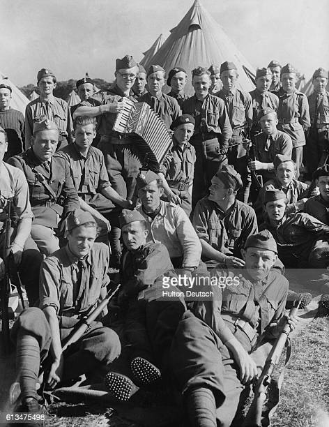 Polish Troops In Britain A happy group of Polish soldiers who are now in camp in this country after having escaped from the Germans in Poland and...