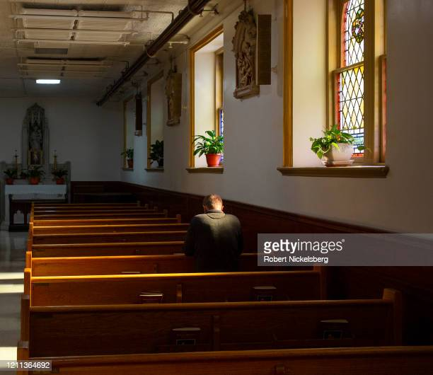 Polish-American man prays in a pew in the main sanctuary at the Saint Anthony-Saint Alphonsus Roman Catholic Church in the Greenpoint neighborhood of...