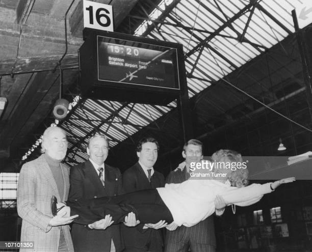 Polishborn actress Ingrid Pitt poses with her costars from the play 'Woman Of Straw' on Platform 16 of Victoria Station London 8th January 1979...