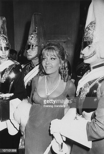 Polishborn actress Ingrid Pitt surrounded by Horse Guards of the Household Cavalry at the London premiere of the film 'Cromwell' 16th July 1970 Pitt...