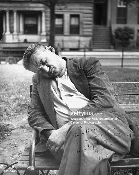 Polishborn American photographer Arthur 'Weegee' Fellig sleeps on a park bench 1940s The picture is signed in the lower right corner and reads 'To...