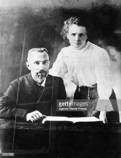 Polishborn chemist Marie Curie posing with her French husband and chemist Pierre Curie