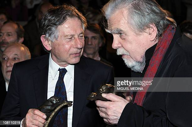 Polishborn French director Roman Polanski chats with French actor Michael Lonsdale after they received respectively the best movie award and the best...