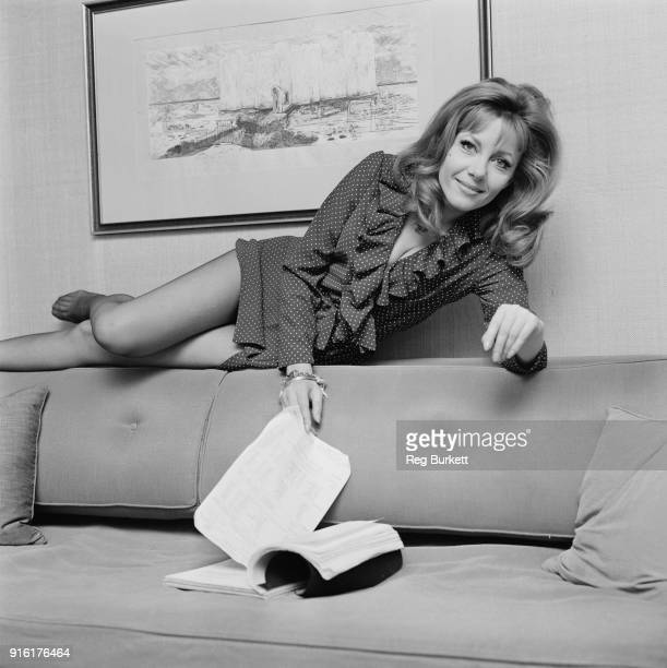 PolishBritish actress and author Ingrid Pitt lying on the back of a sofa UK 26th February 1968
