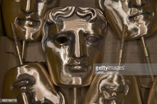 Polished BAFTA masks sit in a box during a photocall at the New Pro Foundries west of London on January 31 2017 The masks will be presented to...