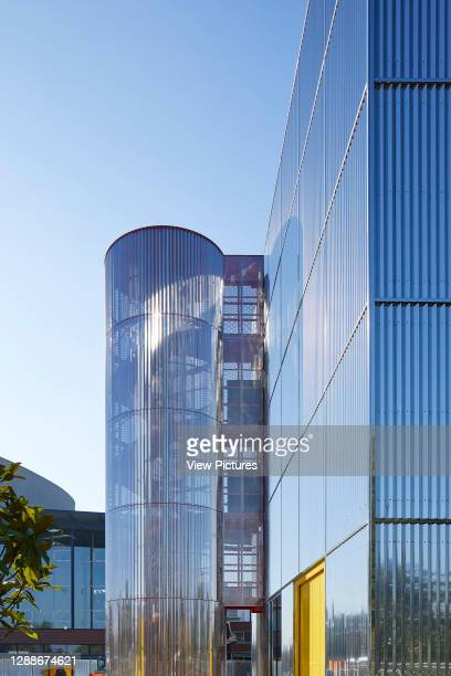 Polished steel facade with cylindrical stairwell. MK Gallery, Milton Keynes, United Kingdom. Architect: 6a Architects, 2019.