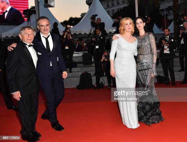 PolishFrench actor Roman Polanski screewriter Olivier Assayas French actress Eva Green and French actress Emmanuelle Seigner leave the screening of...