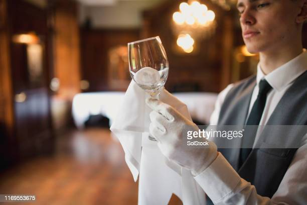 polishing glasses in a luxury restaurant - restaurant stock pictures, royalty-free photos & images