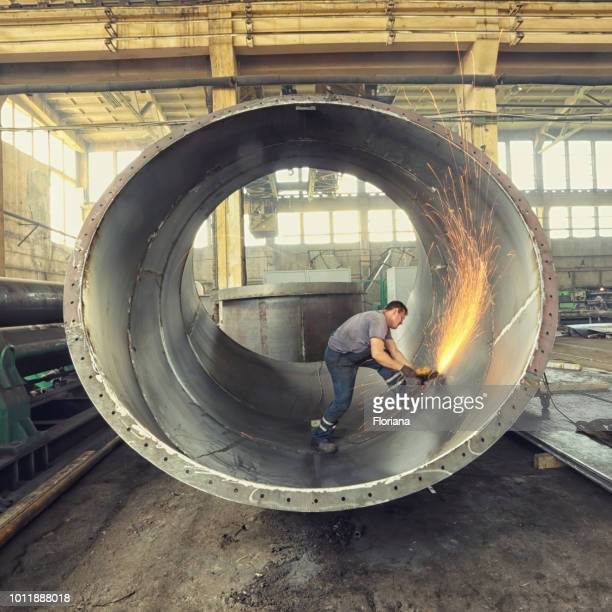 polishing inside of metal cylinder - cylinder stock pictures, royalty-free photos & images