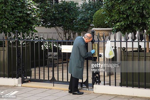 Polishing the brass doorbell in Belgravia London United Kingdom Belgravia is a district in West London in the City of Westminster and the Royal...
