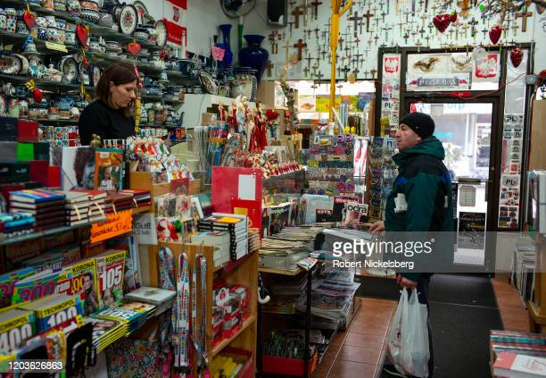 Polish-speaking customer, right, asks a question of one of the employees of the Polonia Bookstore in Greenpoint, New York City February 2, 2020. The...