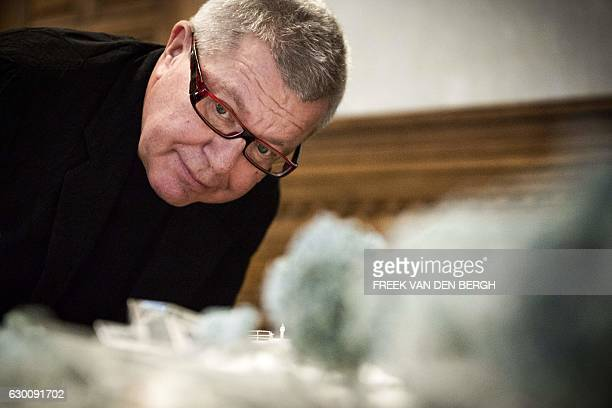 PolishUS architect and artist Daniel Libeskind looks at a scale model during the presentation of the design of the Netherlands' Holocaust Memorial of...