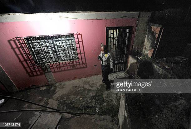 Polisucre's police office patrols an alley of the Sanblas oppositiongoverned neighborhood Petare sector of Caracas August 28 2010 According to...