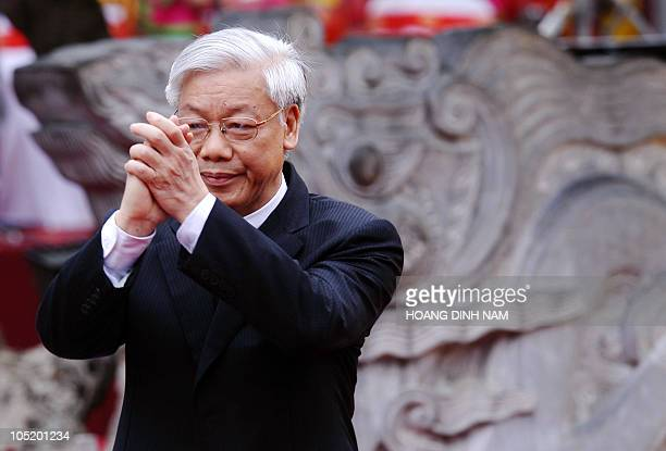 Politburo member and Chairman of the National Assembly Nguyen Phu Trong salutes the audience during a ceremony on October 1 2010 to begin the...