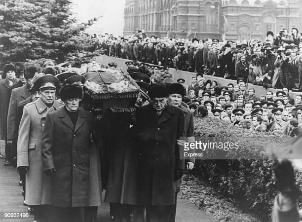 Politburo members carry the open coffin of General Secretary of the Communist Party of the Soviet Union Leonid Brezhnev to his grave in the Kremlin...