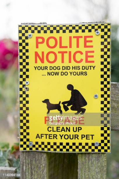 Polite notice your dog did his duty now do yours Please clean up after your pet Suffolk England UK