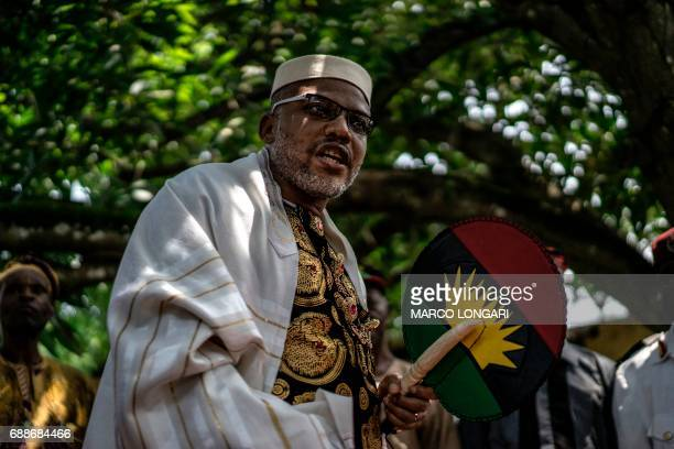 Political activist and leader of the Indigenous People of Biafra movement Nnamdi Kanu wears a Jewish prayer shawl as he walks in his garden at his...
