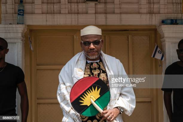 Political activist and leader of the Indigenous People of Biafra movement Nnamdi Kanu wearing a Jewish prayer shawl poses in the garden of his house...