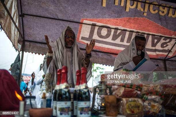 Political activist and leader of the Indigenous People of Biafra movement Nnamdi Kanu stands during celebration of Shabbat in Umuahai on May 27 2017...