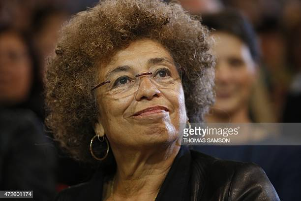 Political activist Angela Davis takes part in a meeting held in Saint-Denis, near Paris, to celebrate the 10th anniversary of anti-racism movement...