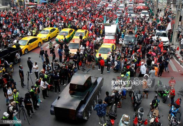 Political activist Nattawut Saikuar, driving a taxi crashed into a mock-up of a tank during a car mob demonstration. More than 1,000 cars and...