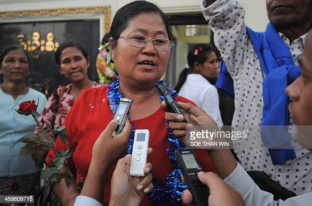 Political activist Naw Ohn Hla speaks to members of the media after she was released from Insein prison in front of the prison in Yangon on December...