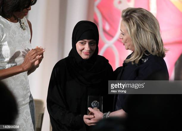 Political activist Samar Badawi of Saudi Arabia is presented with an International Women of Courage Award by US Secretary of State Hillary Clinton as...