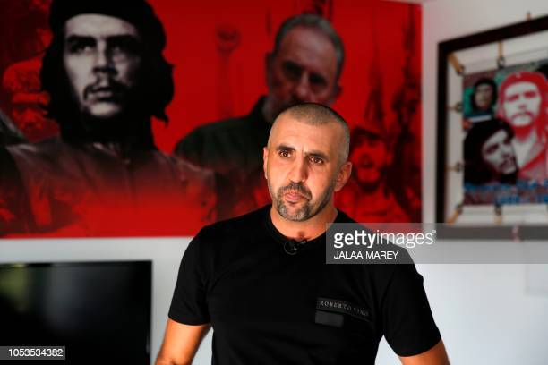 Political activist Sameh Samara poses for a picture in the Druze village of Majdal Shams in the Israeli-annexed Golan Heights on October 21, 2018. -...
