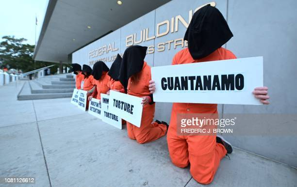 Political activists gather in front of the Federal Building for a demonstration marking the 17th anniversary of the opening of the Guantanamo Bay...