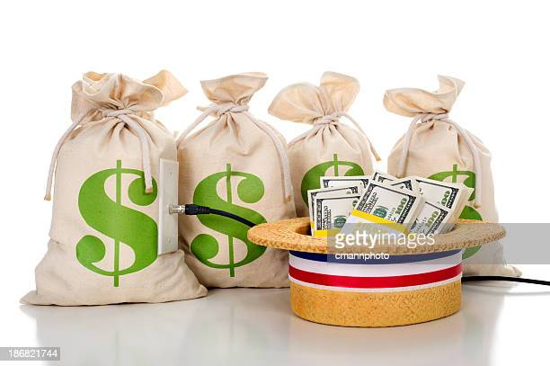political ad with money bags and a hat full of cash. - republican national convention stock pictures, royalty-free photos & images