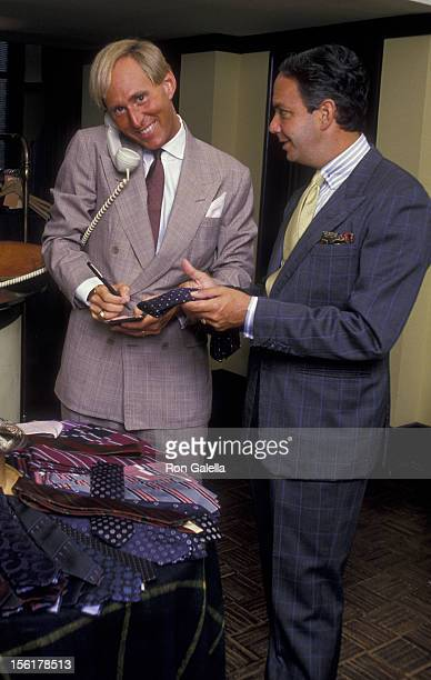 Political Analyst Roger Stone and designer Alan Flusser attend Exclusive Photo Session With Roger Stone on August 19 1987 at Alan Flusser Boutique in...