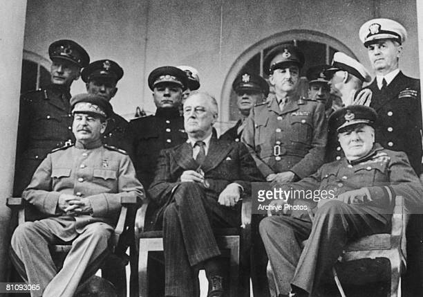 Political and military leaders attend the Tehran Conference during World War II, December 1943. From left to right, , Joseph Stalin, Franklin D....